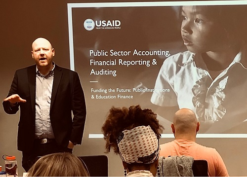 Christopher Cotton at USAID training session